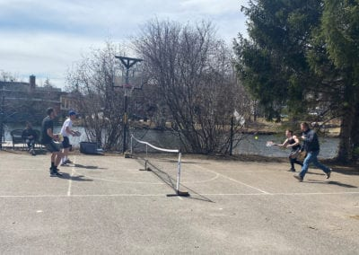 Group of guys playing pickle ball