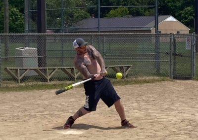 Guy at bat playing softball