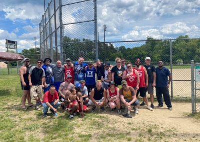 Group of guys playing softball