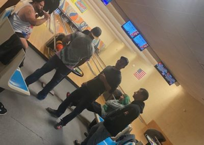 Guys bowling together