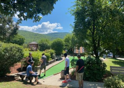 Group of guys playing putt putt