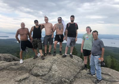 Group of men on the top of a mountain